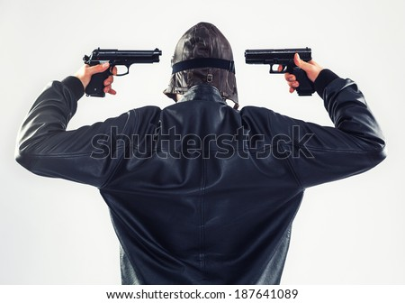 Determined suicidal man is holding two guns pointed to his head - isolated on white