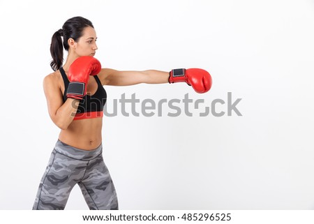 Determined woman boxer training hoping to become world champion one day. Concept of making your dreams come true. Mock up
