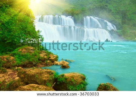 Detian or Ban Gioc waterfall along Vietnamese and Chinese board. - stock photo