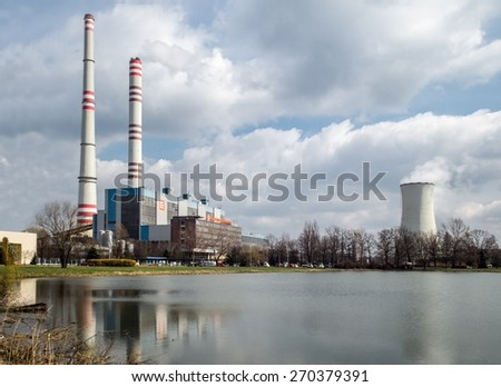 DETMAROVICE, CZECH REPUBLIC - APRIL 7: Detmarovice power plant near Kavina city in Czech Republic reflected in the water of a lake on April 7, 2015.