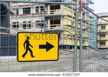 Detour road sign for pedestrian sidewalk near construction site - stock photo