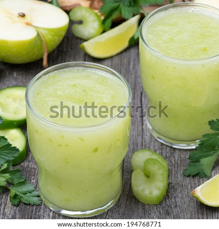 detox cocktail of green apple, celery and lime, close-up - stock photo