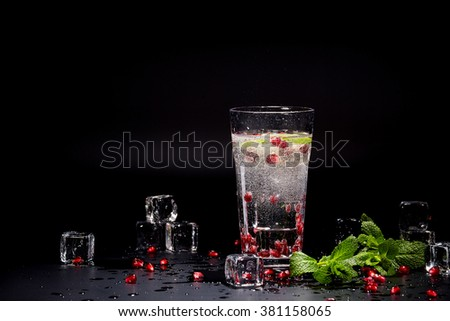 Detox water cocktail on black background