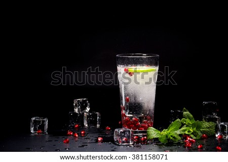 Detox water cocktail on black background - stock photo
