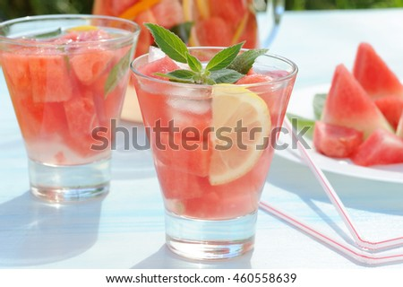 Detox watermelon lemonade drink on rustic table