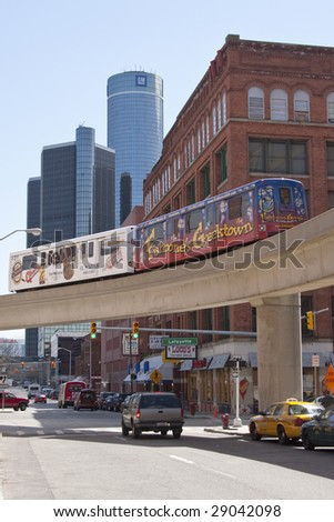 DETROIT - April 11, 2009 - With the headquarters of the financially ailing General Motors in the background, the People Mover crosses a street in Detroit's Greektown. GM is facing possible bankruptcy.