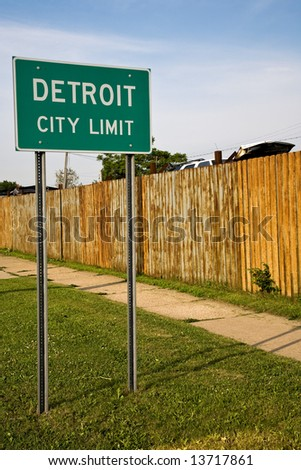 Detroit City Limit Sign and Auto Junkyard. - stock photo