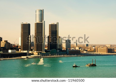 Detroit city skyline and riverfront in daytime - stock photo