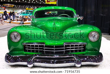 DETROIT - FEB 25: A restored green hot rod on display at the Autorama Show February 25th, 2011 in Detroit, Michigan. - stock photo