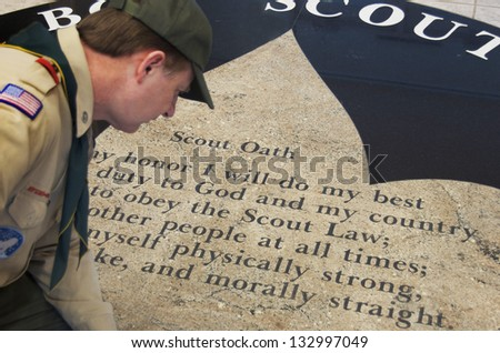 DETROIT - FEB 8,2013: Joe Parton Scoutmaster overlooks BSA Scout Oath on the floor of Dauch Scout Center in Detroit. - stock photo
