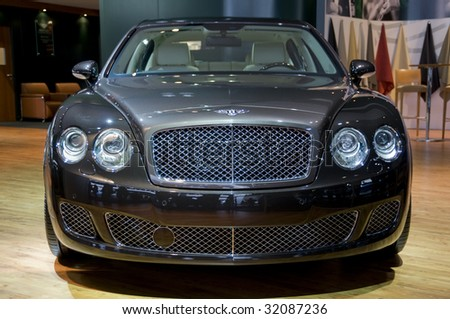 DETROIT- JAN 12 : Bentley Continental GT on display at the North American International Auto Show on January 12, 2009 in Detroit, MI. The annual event is among the largest auto shows in North America. - stock photo