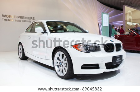 DETROIT - JANUARY 13: A BMW 135i coupe at the 2011 North American International Auto Show Industry Preview on January 13, 2011 in Detroit, Michigan. - stock photo