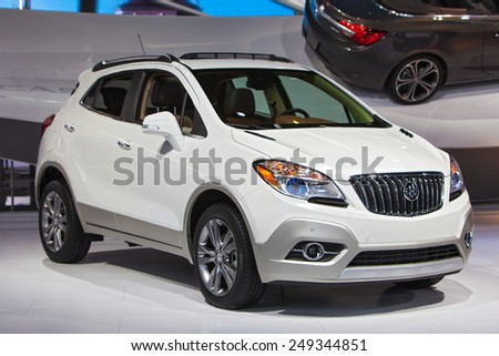 DETROIT - JANUARY 15: A Buick Enclave SUV on display January 15th, 2015 at the 2015 North American International Auto Show in Detroit, Michigan. - stock photo