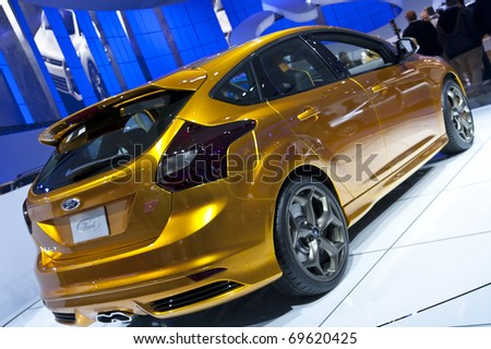 DETROIT - JANUARY 23:  A 2012 Ford focus on display at the North American International Auto Show on January 23, 2011 in Detroit, Michigan. - stock photo
