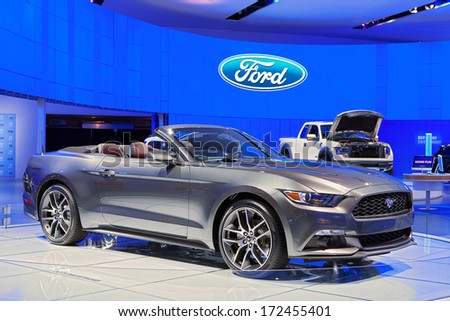 DETROIT - JANUARY 16 : A Ford Mustang Convertible on display at the North American International Auto Show media preview  January 16, 2014 in Detroit, Michigan. - stock photo