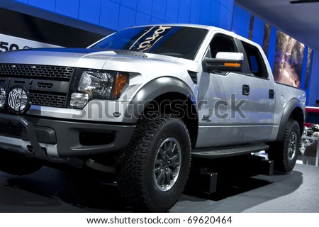 DETROIT - JANUARY 23:  A Ford Raptor on display at the North American International Auto Show on January 23, 2011 in Detroit, Michigan. - stock photo