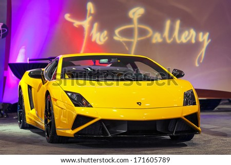 DETROIT - JANUARY 12 : A Lamborghini on display at The Gallery media preview in the MGM Grand Casino January 12, 2014 in Detroit, Michigan. - stock photo