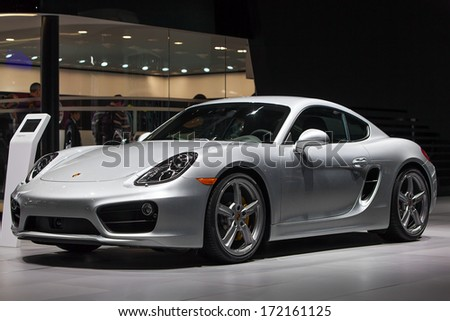 DETROIT - JANUARY 13 : A Porsche 911 Carerra on display at the North American International Auto Show media preview  January 13, 2014 in Detroit, Michigan. - stock photo