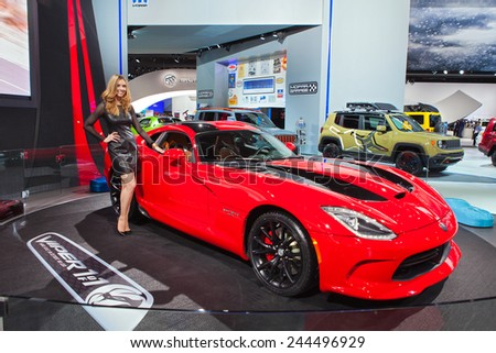 DETROIT - JANUARY 13: A show model poses with the Dodge Viper  January 13th, 2015 at the 2015 North American International Auto Show in Detroit, Michigan. - stock photo