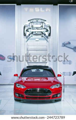 DETROIT - JANUARY 13: A Tesla Model S on display January 13th, 2015 at the 2015 North American International Auto Show in Detroit, Michigan. - stock photo