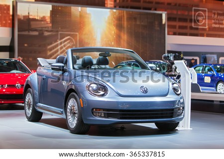 DETROIT - JANUARY 12: A Volkswagen Beetle convertible on display at the North American International Auto Show media preview January 12, 2016 in Detroit, Michigan. - stock photo