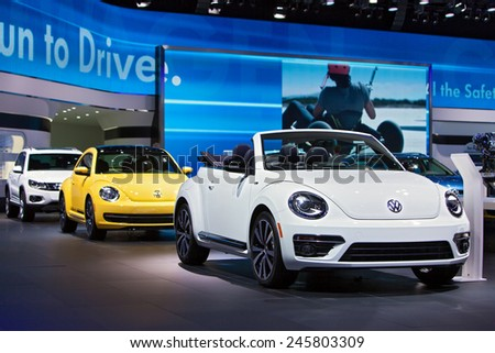 DETROIT - JANUARY 13: A VolkswagenBeetle convertible on display January 13th, 2015 at the 2015 North American International Auto Show in Detroit, Michigan. - stock photo