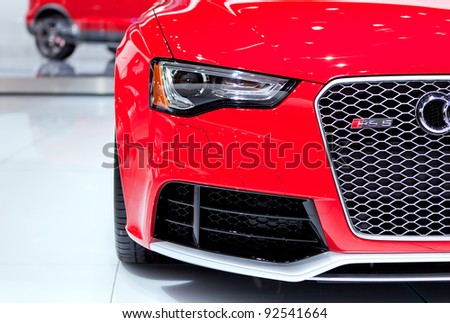 DETROIT - JANUARY 11: Audi RS5 headlamp at the 2012 North American International Auto Show Industry Preview on January 11, 2012 in Detroit, Michigan. - stock photo