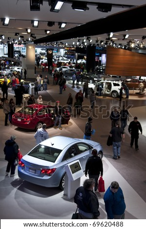 DETROIT - JANUARY 23:  Concept and new release cars on display at the North American International Auto Show on January 23, 2011 in Detroit, Michigan. - stock photo