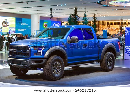 DETROIT - JANUARY 12: Ford debuts the new Raptor pickup truck January 12th, 2015 at the 2015 North American International Auto Show in Detroit, Michigan. - stock photo