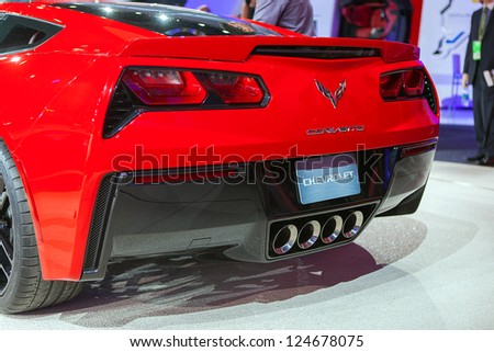 DETROIT - JANUARY14 : Rear view of the new 2014 Corvette Stingray at the NAIAS media preview January 14, 2013 in Detroit, Michigan. - stock photo