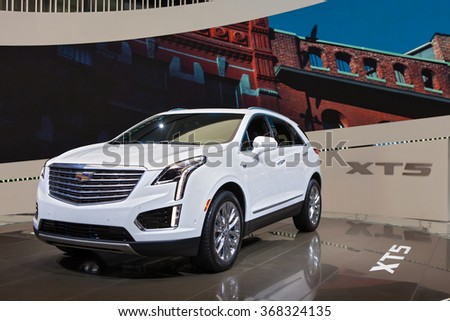 DETROIT - JANUARY 12: The 2017 Cadillac XT5 on display at the North American International Auto Show media preview January 12, 2016 in Detroit, Michigan. - stock photo