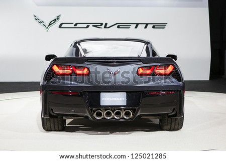 DETROIT - JANUARY 15 : The 2014 Corvette Stingray rear view at The North American International Auto Show  January 15, 2013 in Detroit, Michigan. - stock photo