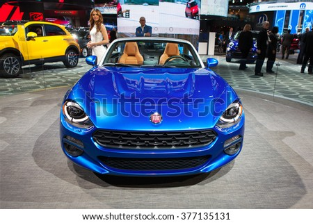 DETROIT - JANUARY 11: The Fiat 124 Spyder concept on display at the North American International Auto Show media preview January 11, 2016 in Detroit, Michigan. - stock photo