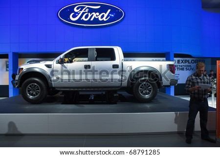 DETROIT - JANUARY 10: The 2011 Ford F-250 SVT on display at the North American International Auto Show Press Preview on January 10, 2011 in Detroit, Michigan. - stock photo