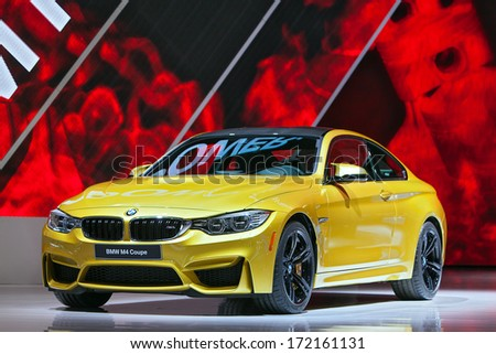 DETROIT - JANUARY 13 : The new BMW M4 Coupe on display at the North American International Auto Show media preview  January 13, 2014 in Detroit, Michigan. - stock photo