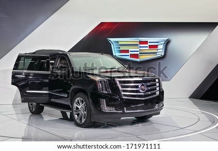 DETROIT - JANUARY 13 : The new Cadillac Escalade on display at the North American International Auto Show media preview  January 13, 2014 in Detroit, Michigan. - stock photo