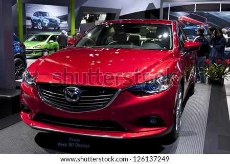 DETROIT - JANUARY 27 :The new 2014 Mazda A6 at The North American International Auto Show January 27, 2013 in Detroit, Michigan. - stock photo