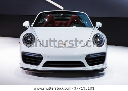 DETROIT - JANUARY 11: The new Porsche 911 Turbo on display at the North American International Auto Show media preview January 11, 2016 in Detroit, Michigan. - stock photo