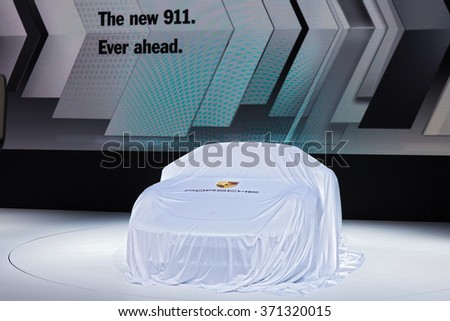DETROIT - JANUARY 11: The new Porsche 911 under wraps at the North American International Auto Show media preview January 11, 2016 in Detroit, Michigan. - stock photo