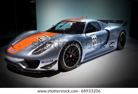 DETROIT - JANUARY 11: The Porsche 918 RSR makes it debut at the 2011 North American International Auto Show Press Preview on January 11, 2011 in Detroit, Michigan. - stock photo