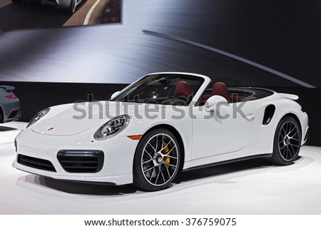 DETROIT - JANUARY 11: The 2016 Porsche 911 Turbo on display at the North American International Auto Show media preview January 11, 2016 in Detroit, Michigan. - stock photo