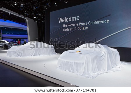 DETROIT - JANUARY 11: The Porsche 911 Turbo under cover before the premiere at the North American International Auto Show media preview January 11, 2016 in Detroit, Michigan. - stock photo