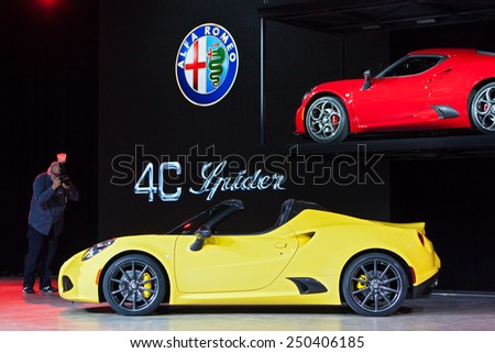 DETROIT - JANUARY 12: The world premiere of the Alfa Romeo 4C Spider January 12th, 2015 at the 2015 North American International Auto Show in Detroit, Michigan. - stock photo