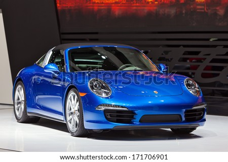 DETROIT - JANUARY 14 : The World premiere of the new Porsche 911 Targa at the North American International Auto Show media preview  January 14, 2014 in Detroit, Michigan. - stock photo