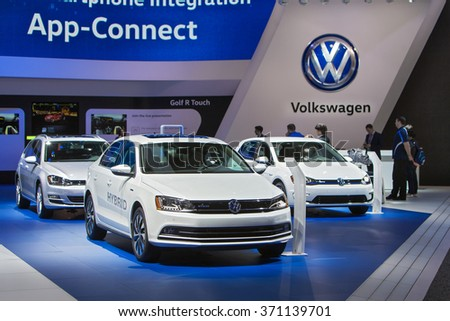 DETROIT - JANUARY 12: Volkswagen sedans on display at the North American International Auto Show media preview January 12, 2016 in Detroit, Michigan. - stock photo