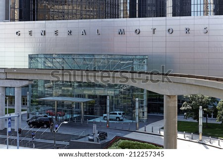 DETROIT JULY 31: People exit the General Motors World Headquarters building located in Detroit, Michigan on July 31, 2014. General Motors is an American multinational automobile corporation. - stock photo