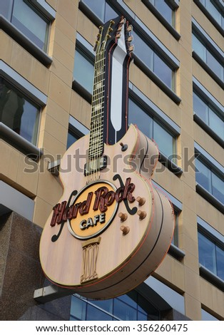 DETROIT, MI - DECEMBER 24: The Detroit, MI Hard Rock Cafe, whose guitar logo is shown on December 24, 2015, houses memorabilia from many Michigan musicians.  - stock photo