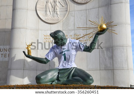 DETROIT, MI - DECEMBER 24: The Spirit of Detroit monument in Detroit, MI, is covered in a Michigan State University shirt on December 24, 2015.  - stock photo