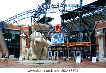 DETROIT, MI - JULY 6: Fans walk past entry of Comerica Park, home of the Detroit Tigers, on July 6, 2014. The Tigers lost to the Tampa Bay rays that night 7-3.  - stock photo