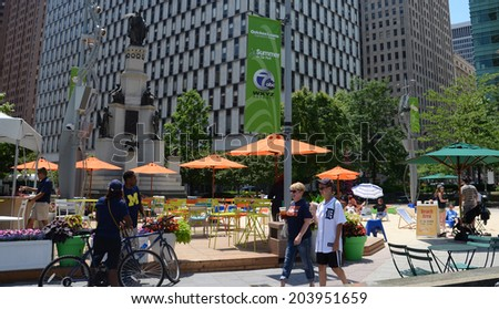 DETROIT, MI - JULY 6: People enjoying the revitalized Campus Martius park in Detroit, MI, on July 6, 2014. - stock photo